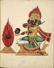 220px-The_three-headed_rakshasa_Trishiras_sits_in_lalitasana_on_a_throne_facing_a_fire_altar_in_which_a_severed_head_is_burning